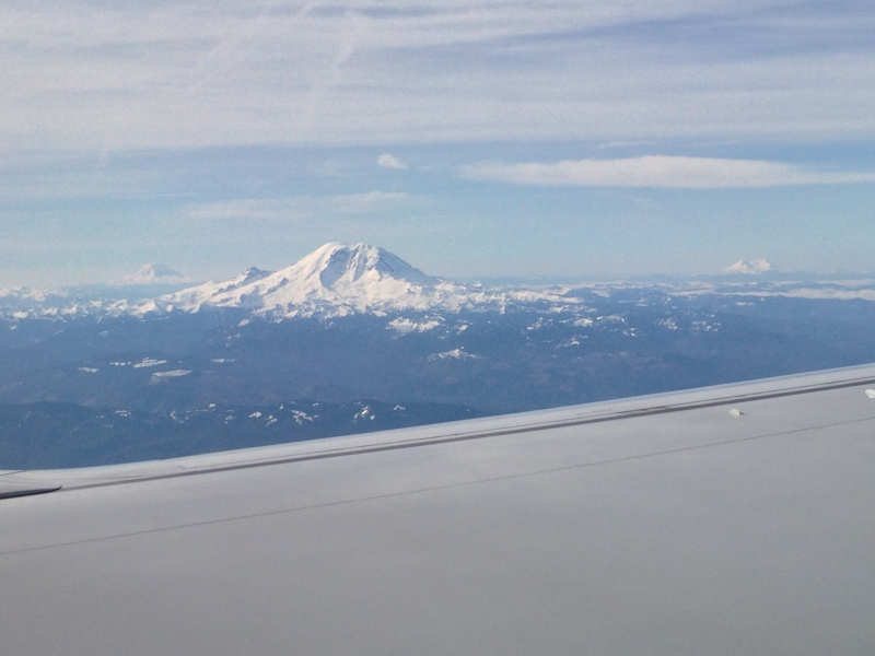 Flying into Seattle with Mt Rainier, Mt Saint Helens and Mt Adams off in the distance