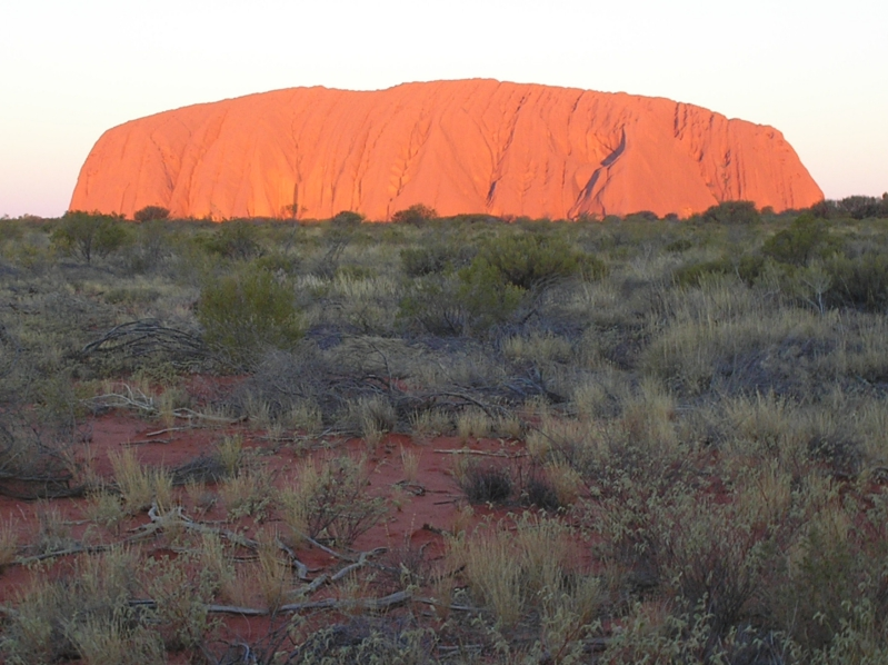 The Sun Setting On Ayer's Rock/Uluru In Outback